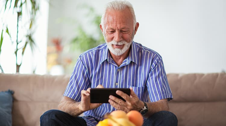 Older man using a tablet