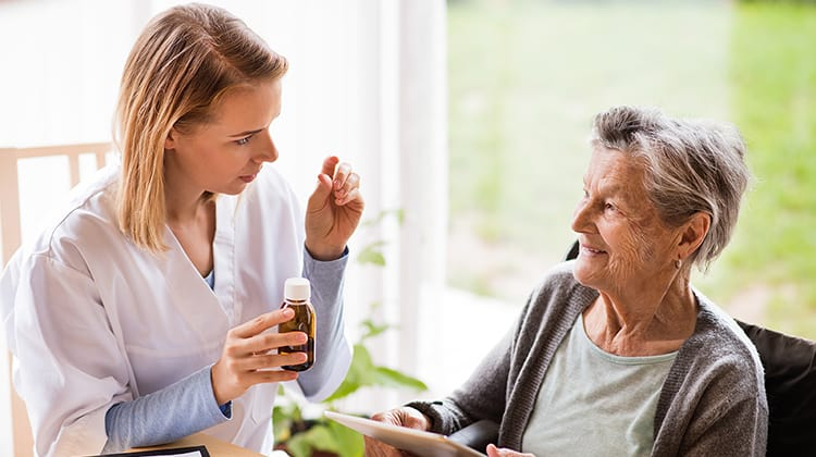 Health visitor and a senior woman with tablet.