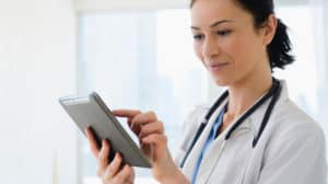 Female Doctor using Tablet
