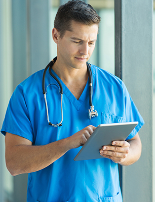 professional doctor using tablet pc in hospital